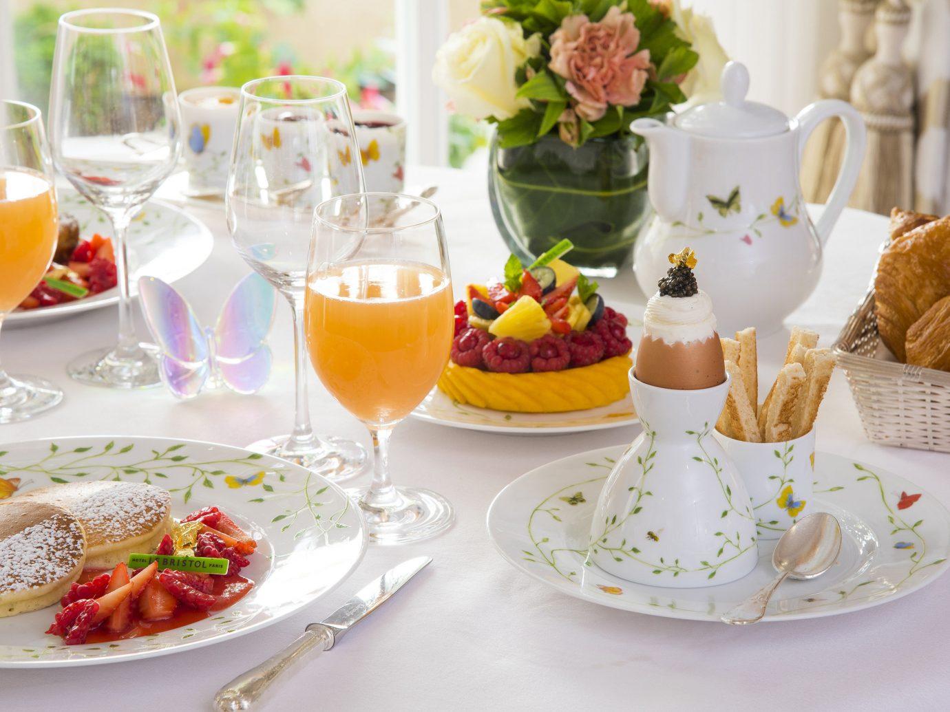 Food + Drink plate meal brunch yellow breakfast tableware food table stemware dessert serveware wine glass supper dining table
