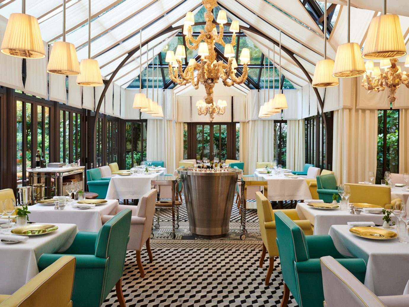 Dining Drink Eat France Hotels Offbeat Paris Trip Ideas table chair green indoor room meal restaurant Resort function hall estate interior design area furniture several