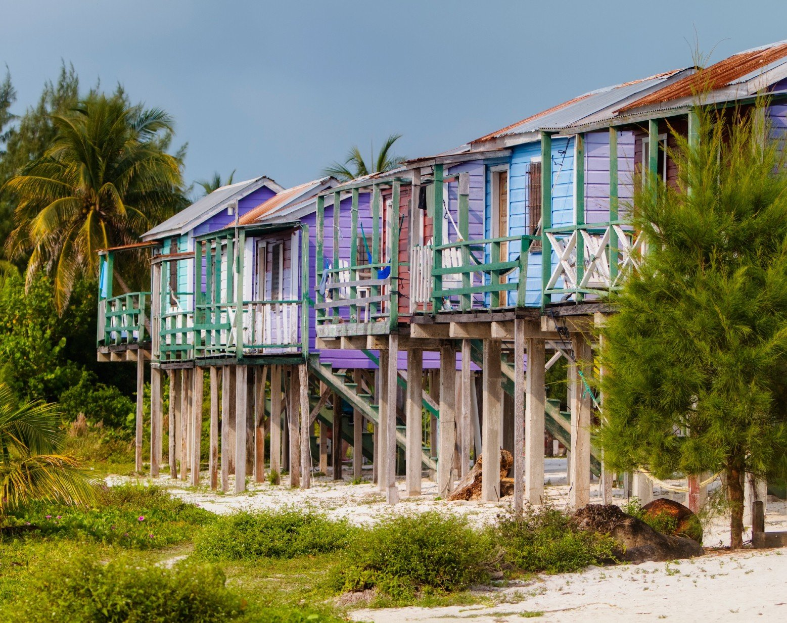 caribbean Secret Getaways Trip Ideas tree outdoor sky grass building house home residential area vacation estate Resort real estate Village cottage walkway shack old