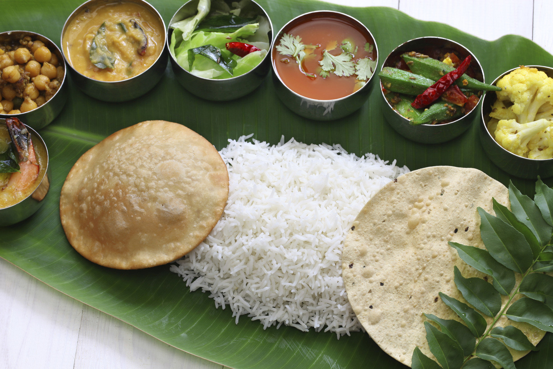Travel Tips food plate dish meal cuisine asian food fish lunch indian cuisine southeast asian food steamed rice several meat
