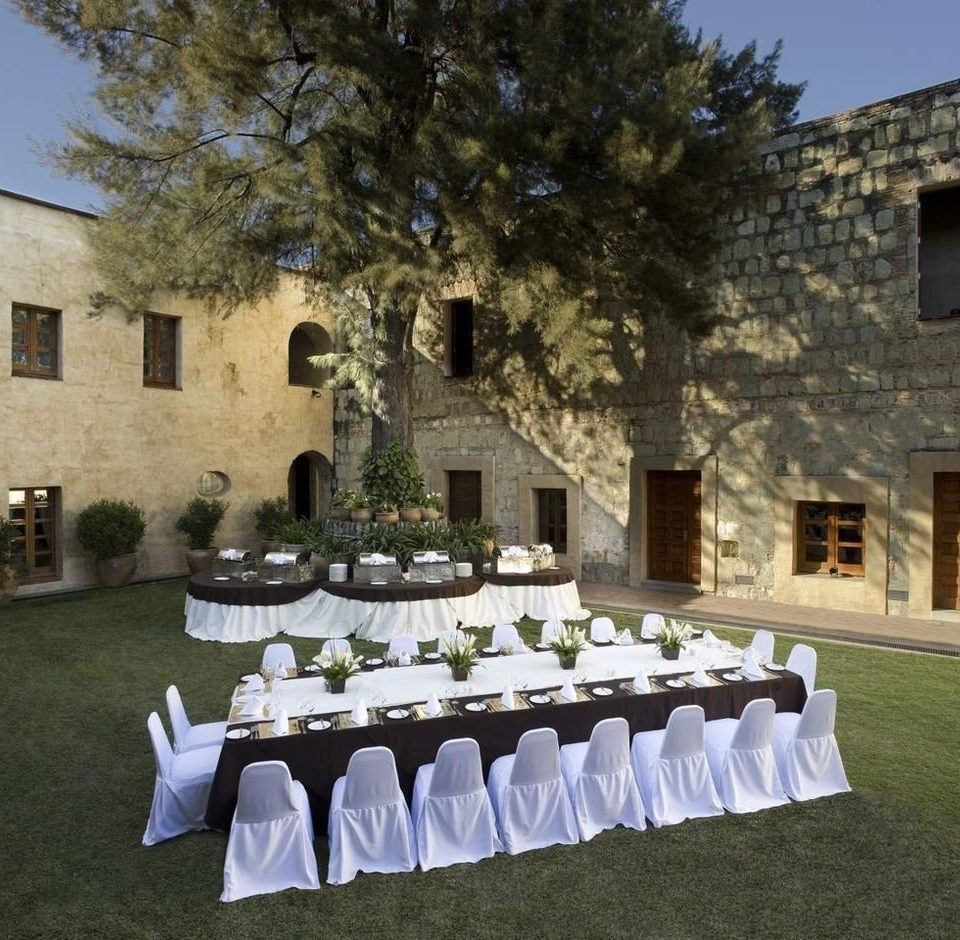 building grass ceremony wedding white backyard row banquet flower mansion stone colored