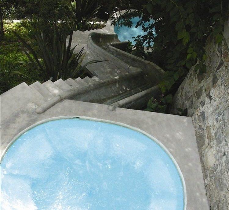 tree swimming pool water backyard pond bathtub stone