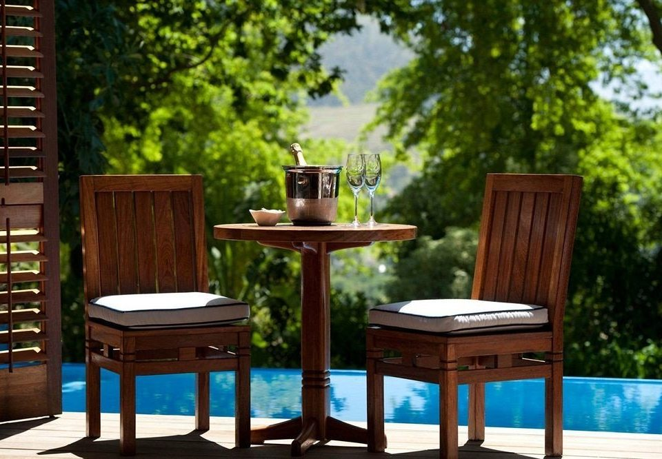 tree chair outdoor structure backyard dining table
