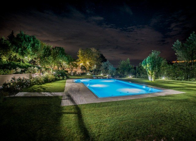 grass swimming pool structure landscape lighting sport venue lawn mansion backyard golf course screenshot grassy