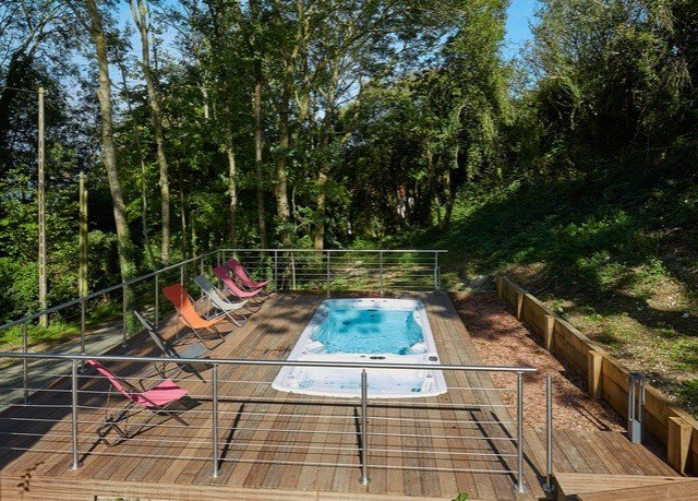 tree swimming pool backyard outdoor structure walkway pond wooded surrounded