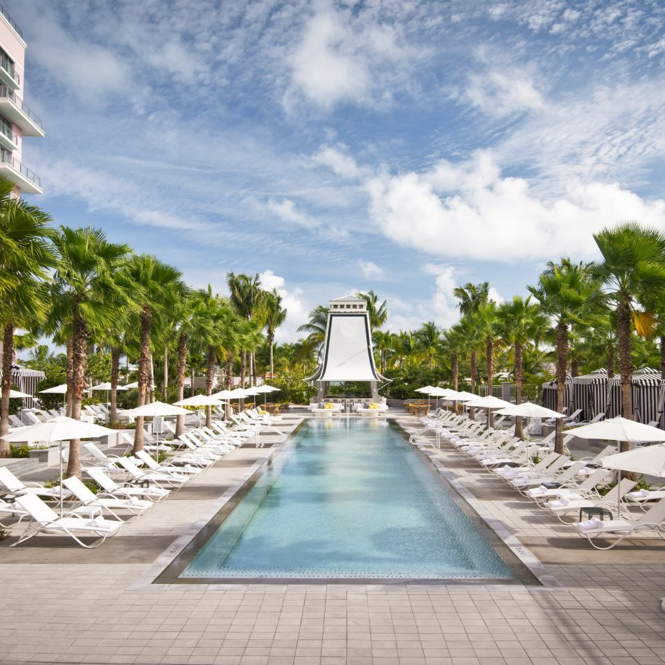 Bahamas caribbean Trip Ideas Resort arecales palm tree tree swimming pool walkway leisure residential area condominium water sky reflecting pool outdoor structure