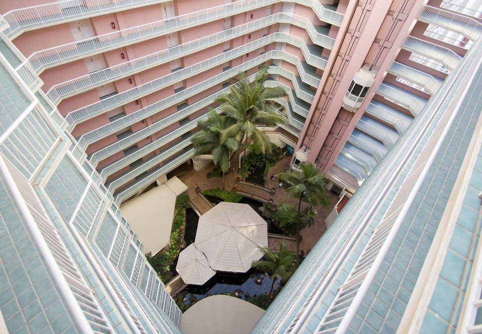 building Balcony property condominium house home roof stairs plant outdoor structure siding backyard porch