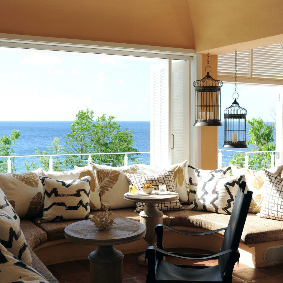 Balcony Bar Beach Beachfront Drink Eat Elegant Island Lounge Scenic views Waterfront property living room condominium home Villa Suite cottage