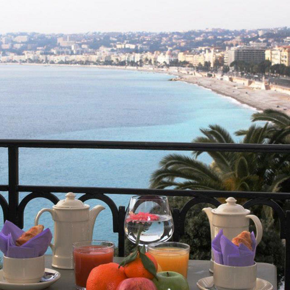 Balcony Bar Dining Drink Eat Elegant Scenic views sky water Coast Sea overlooking Beach Resort shore
