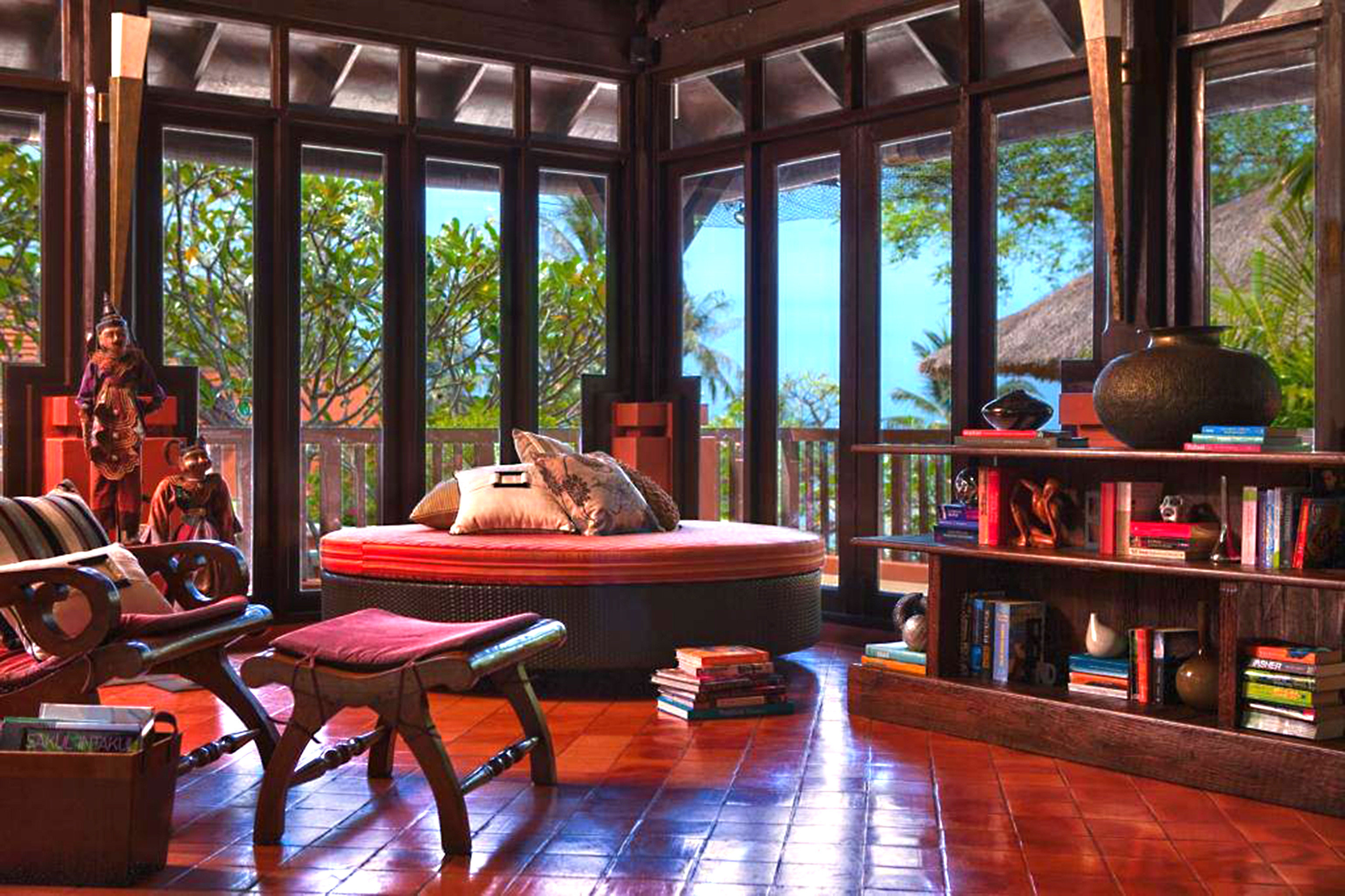 Balcony Beachfront Cultural Jungle Lounge Resort Romantic Tropical Waterfront leisure building recreation room home restaurant Bar living room dining table