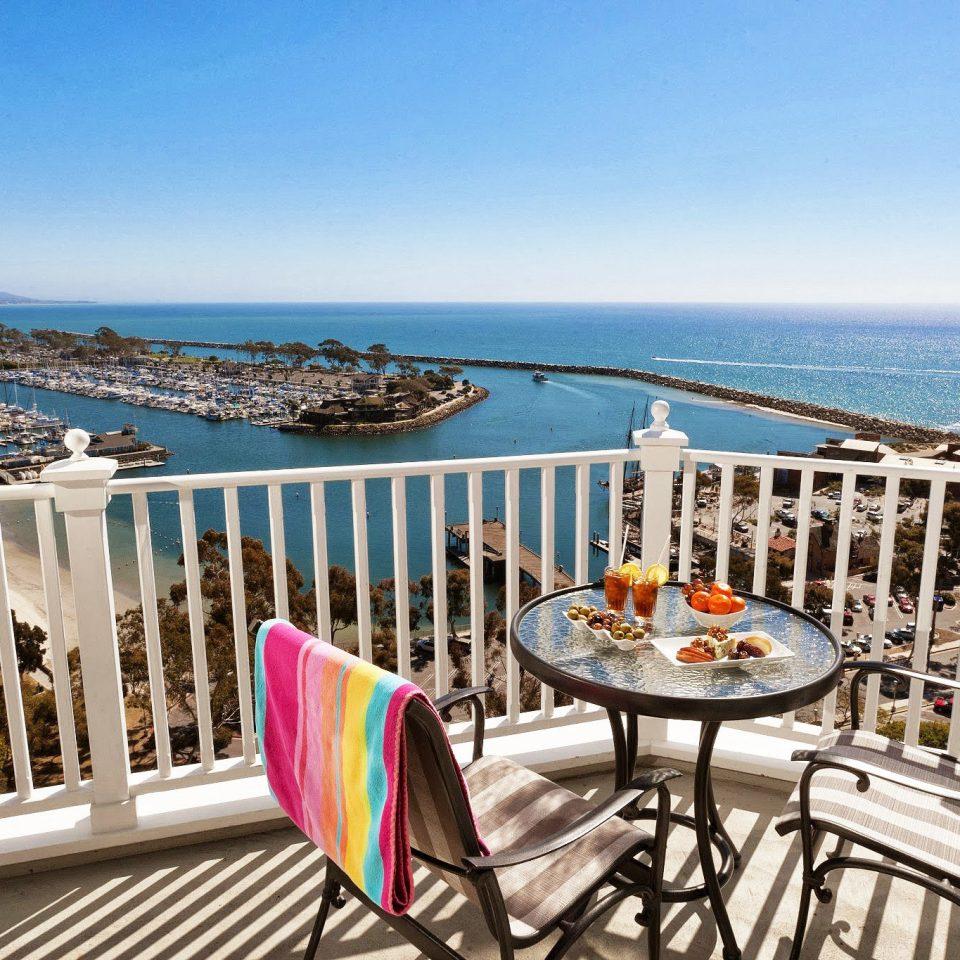 Bar Beachfront Dining Drink Eat Ocean sky chair leisure property Deck Resort home Villa overlooking cottage Balcony porch