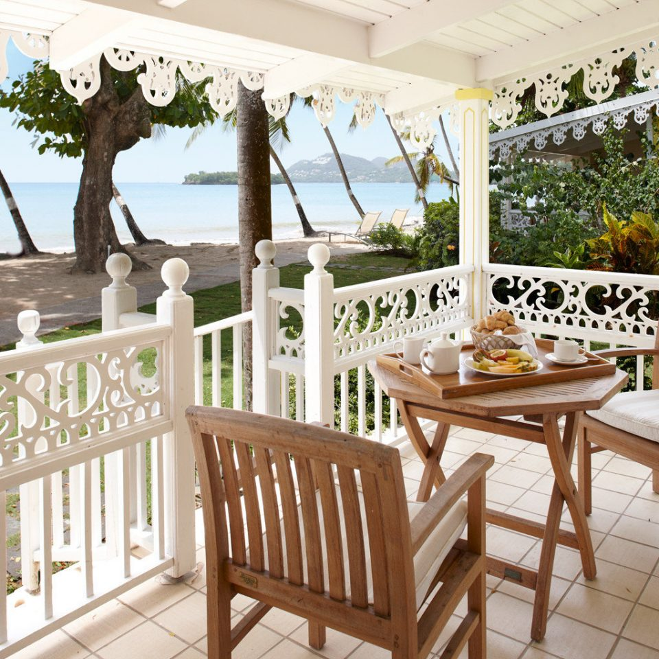Bar Dining Drink Eat Hip Scenic views Tropical chair property building porch home Villa cottage wooden Balcony outdoor structure Resort backyard Deck