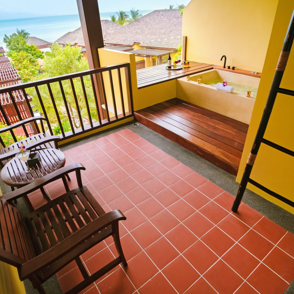Balcony Bath Beachfront Honeymoon Hot tub/Jacuzzi Jungle Romance Scenic views Tropical Waterfront chair property yellow house home cottage Villa step