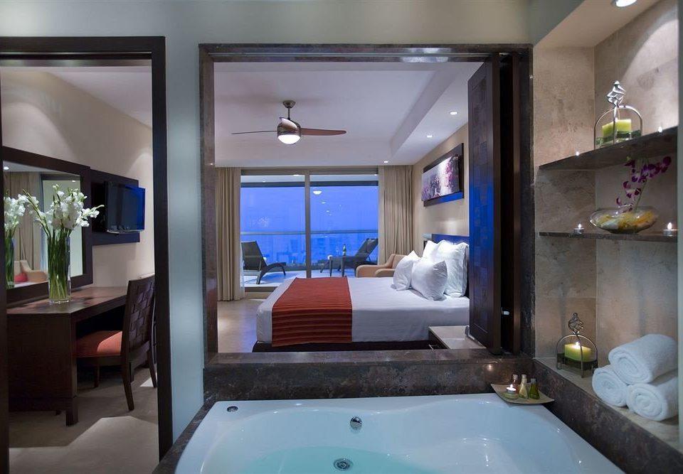 Balcony Bedroom Hip Luxury Scenic views Suite bathroom property sink swimming pool house home yacht condominium tub Bath