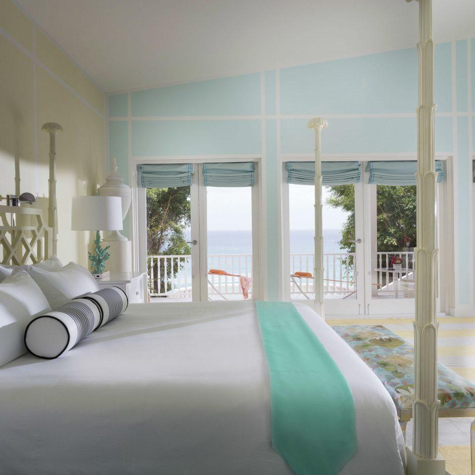 Balcony Beach Beachfront Bedroom Elegant Hotels Island Luxury Scenic views Suite Terrace Trip Ideas Waterfront property green living room home condominium