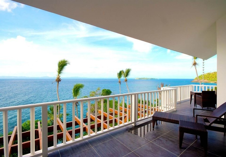 Beach Beachfront Buildings Exterior Ocean sky property leisure Deck condominium Resort Villa caribbean swimming pool home Balcony porch overlooking shore