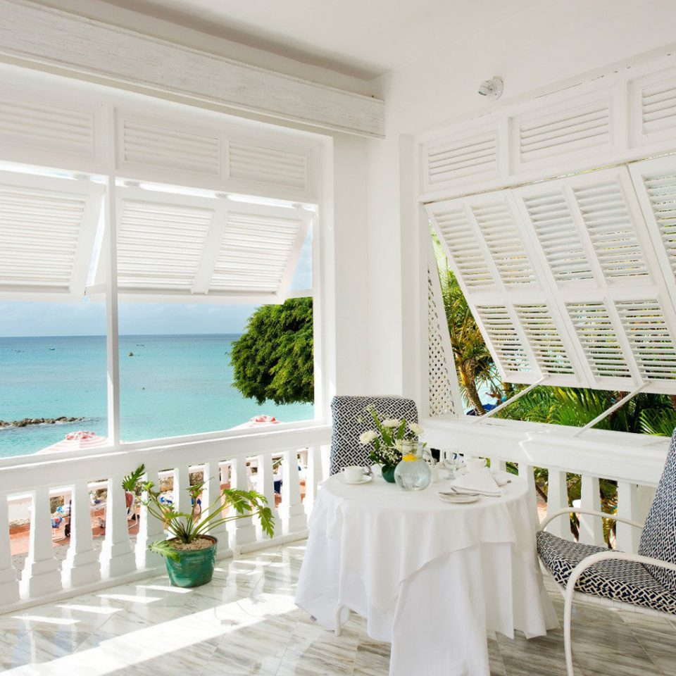 Balcony Beach Beachfront Country Elegant Island Lounge Nature Outdoors Scenic views Terrace Trip Ideas Waterfront property white home porch