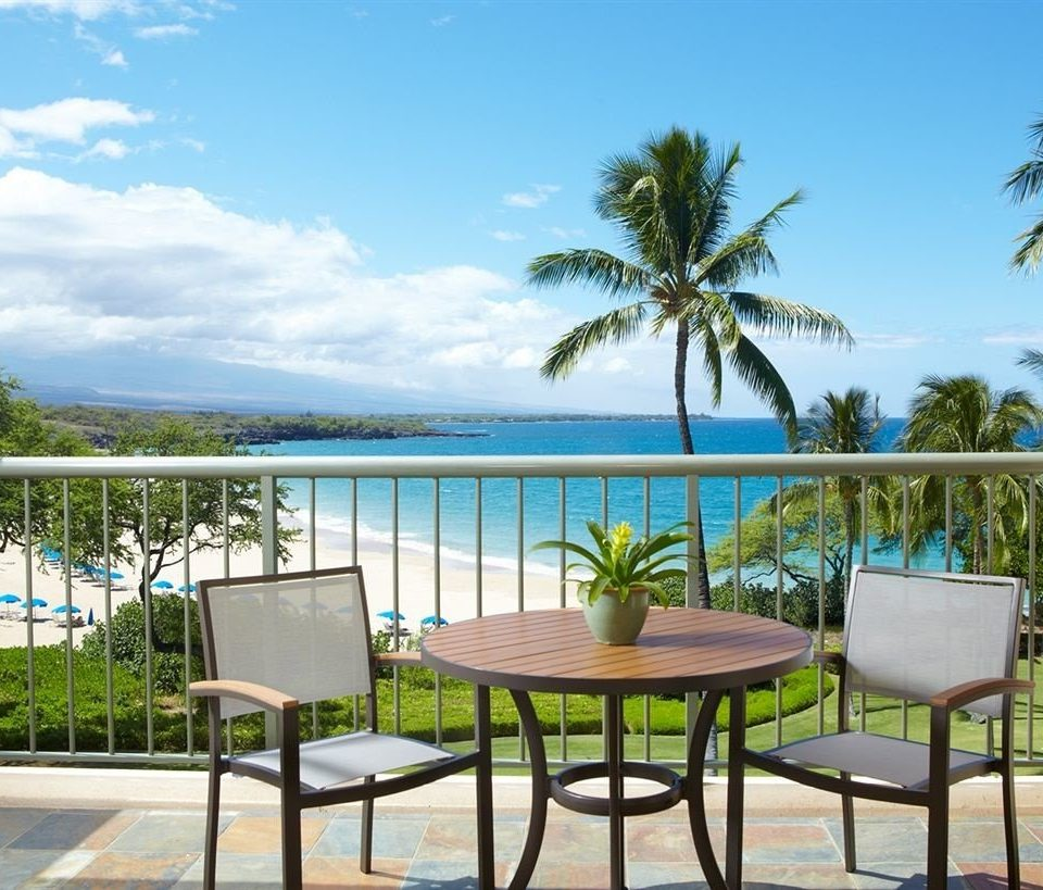 Balcony Beach Beachfront Ocean Scenic views tree sky palm chair property leisure caribbean Resort swimming pool Villa condominium Deck porch lined