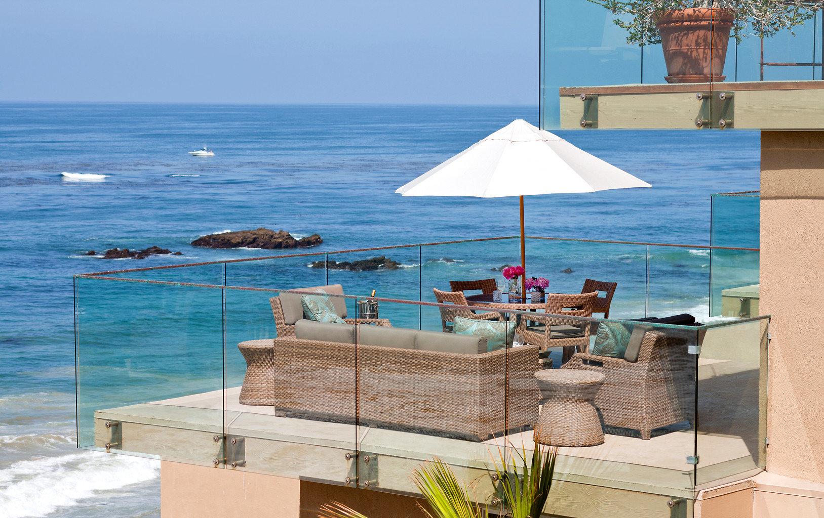 Balcony Beachfront Deck Elegant Lounge Modern Patio Terrace Waterfront water sky chair property Sea Ocean Resort swimming pool Beach caribbean Villa shore day