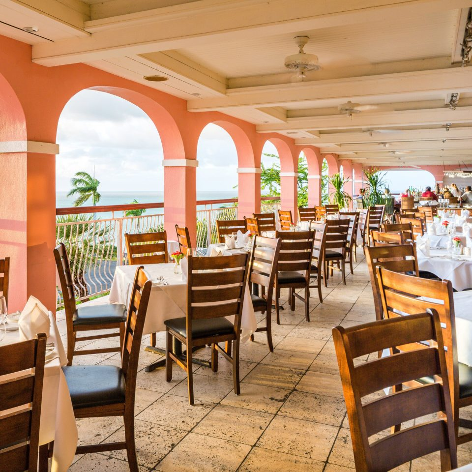 Balcony Beach Beachfront Dining Island Scenic views chair restaurant Resort function hall overlooking set