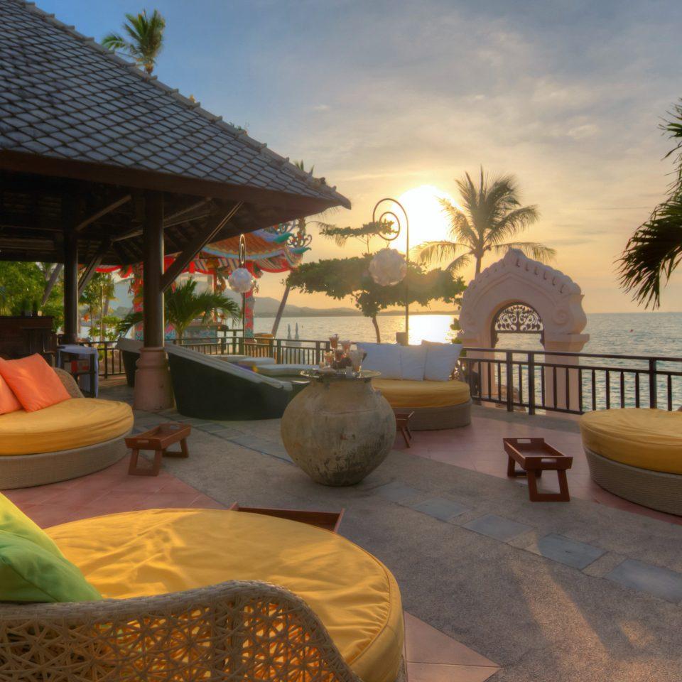 Balcony Beach Beachfront Honeymoon Lounge Outdoors Patio Romantic Scenic views Sunset Tropical Waterfront property Resort Villa swimming pool hacienda home cottage backyard