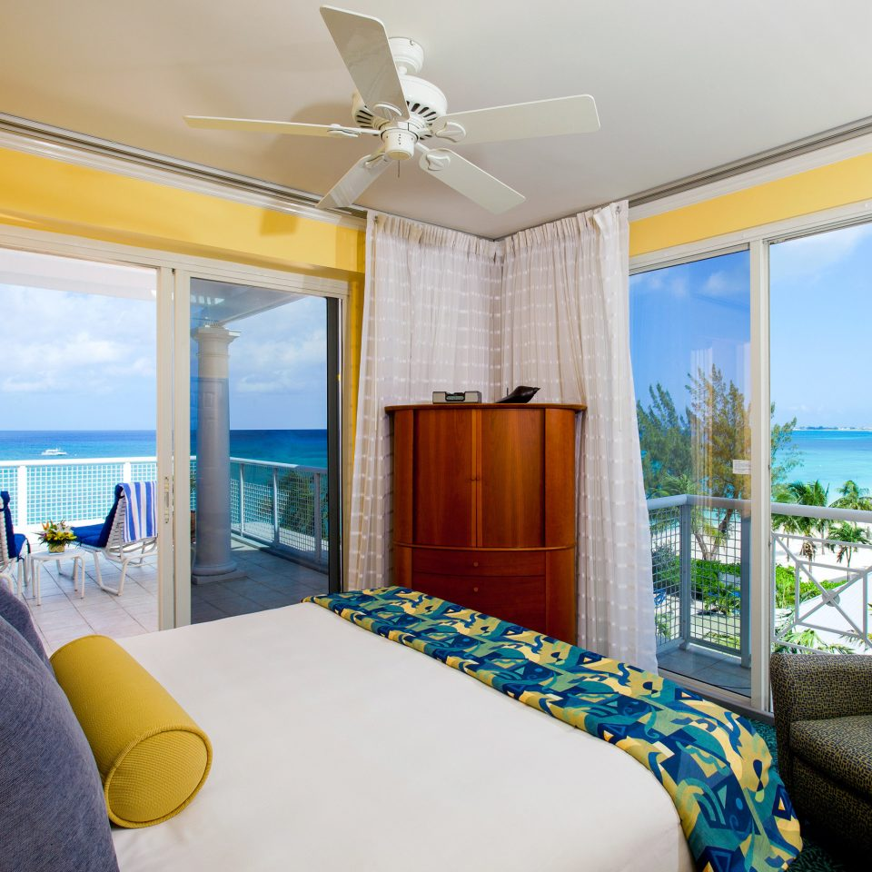 Balcony Beach Bedroom Honeymoon Modern Romance Romantic sofa property Suite condominium yellow home living room cottage Villa overlooking