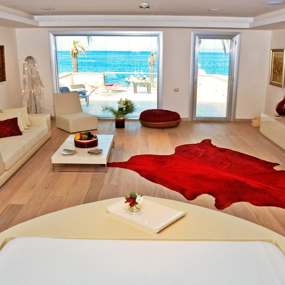 Balcony Beach Modern Scenic views property Suite living room Bedroom home bed sheet Villa cottage