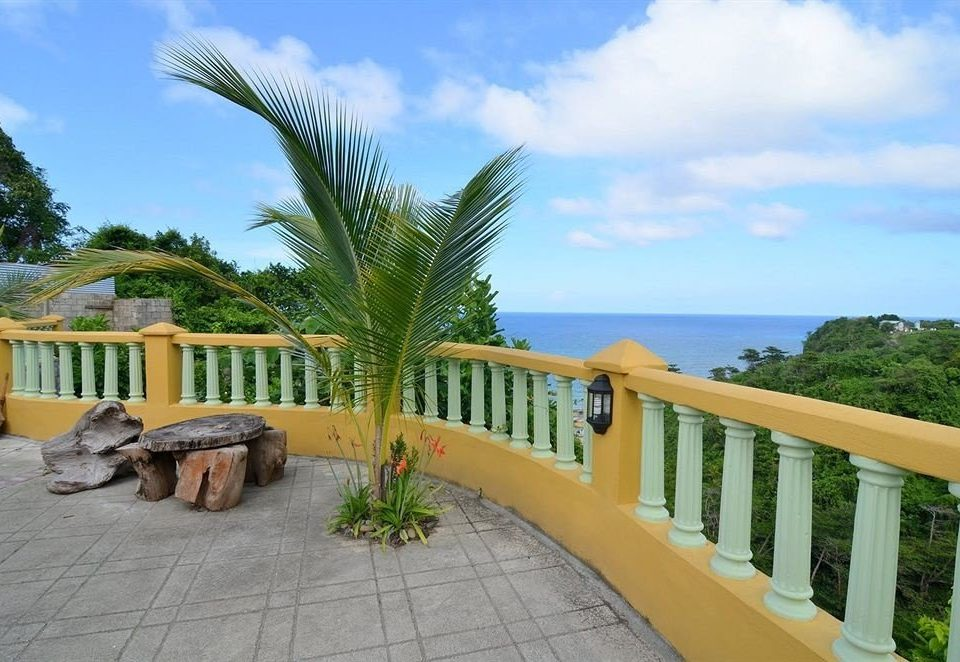 Balcony Budget Ocean Patio Rustic Scenic views Tropical sky tree ground property Resort Villa caribbean arecales home Beach walkway hacienda condominium mansion plant cottage swimming pool palm porch Deck