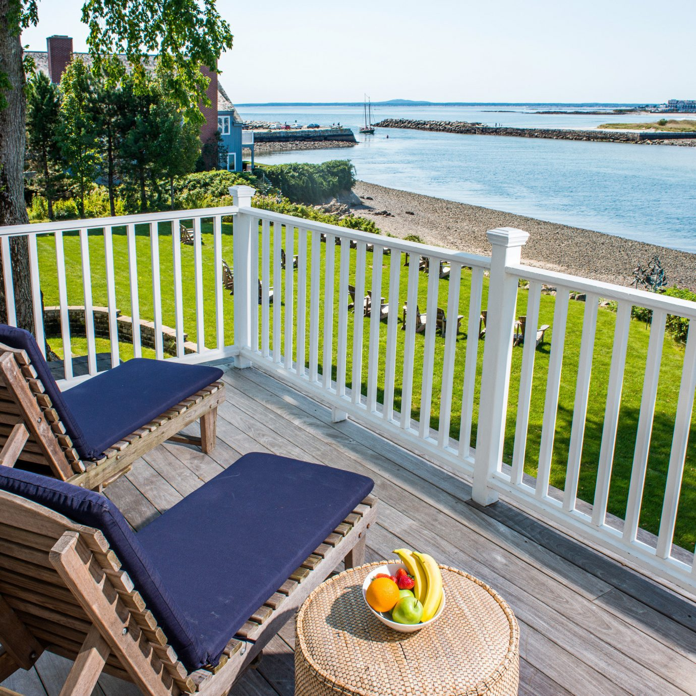 Balcony Classic Elegant Inn Lounge Waterfront Fence sky leisure chair property wooden walkway Resort Beach swimming pool home Deck Villa cottage backyard outdoor structure overlooking porch