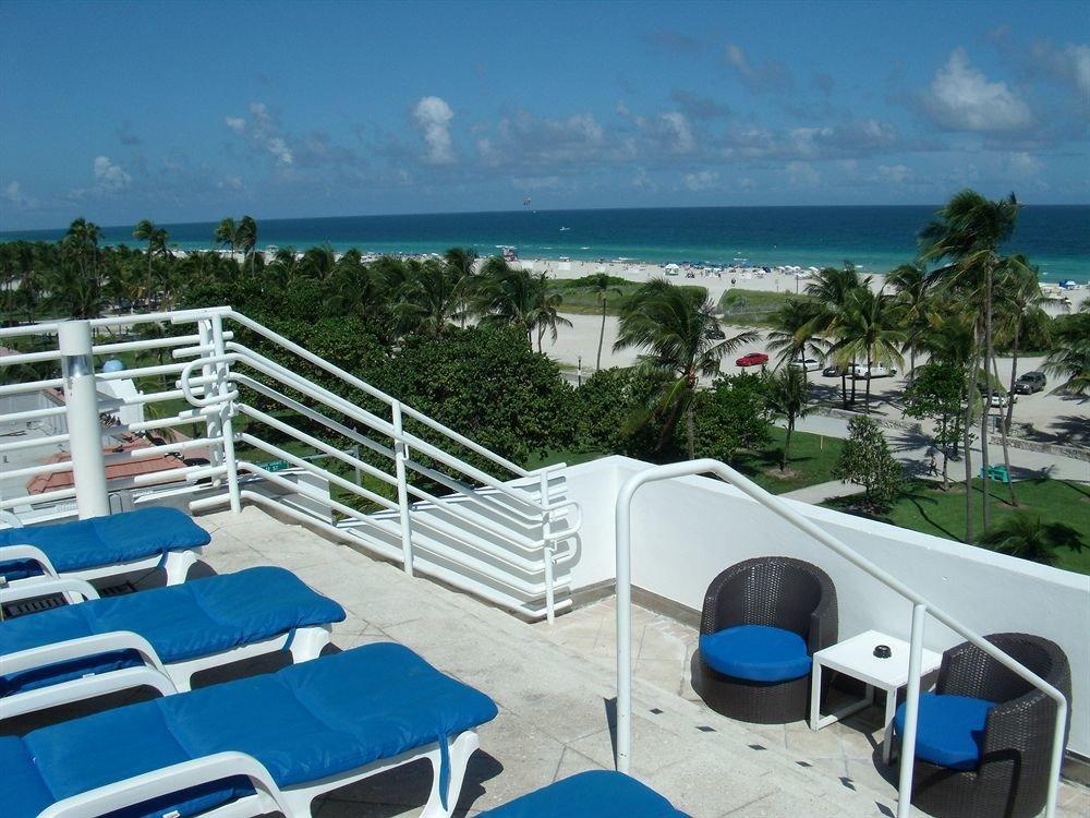 Balcony Beach Classic sky leisure swimming pool chair property caribbean Resort Villa dock marina Deck overlooking shore sandy