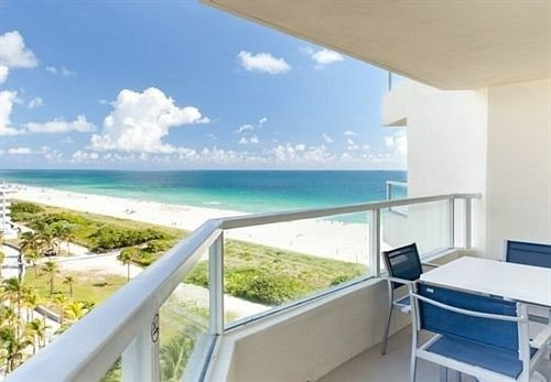 Balcony Beach Classic sky Ocean property swimming pool overlooking condominium Villa white caribbean Deck home Resort cottage porch Island shore