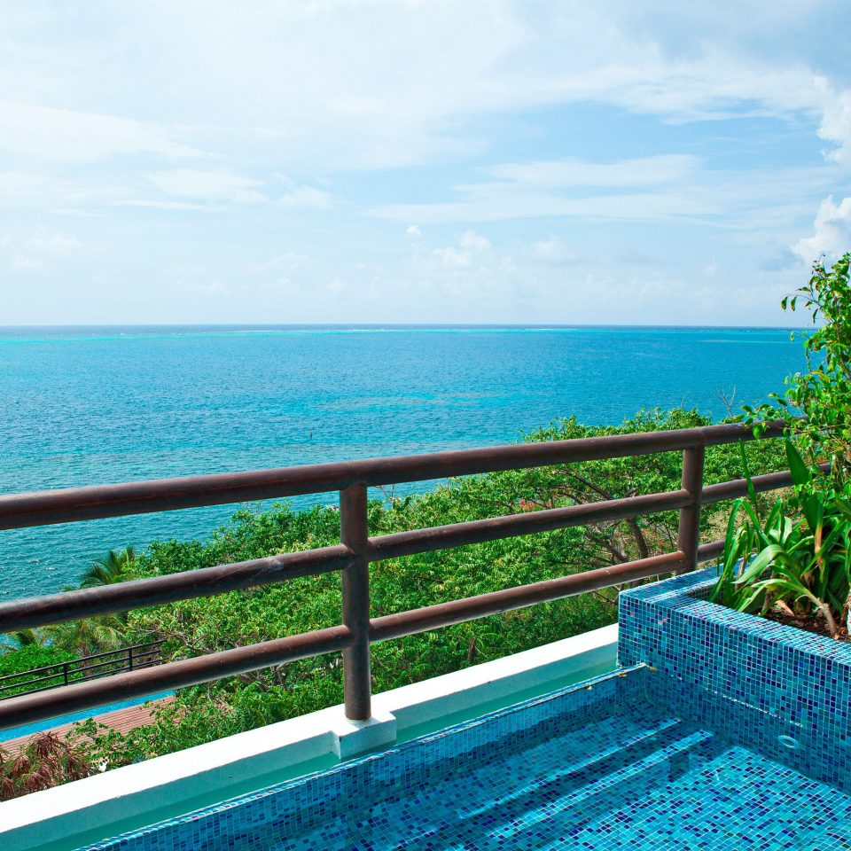 Balcony Deck Play Pool Resort Scenic views Waterfront sky water swimming pool caribbean property Sea Ocean overlooking Beach Lagoon tropics Coast Villa Island blue railing