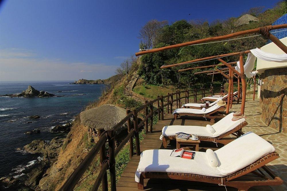 Balcony Exterior Resort Waterfront sky chair Coast Sea Beach Ocean cape vehicle travel overlooking