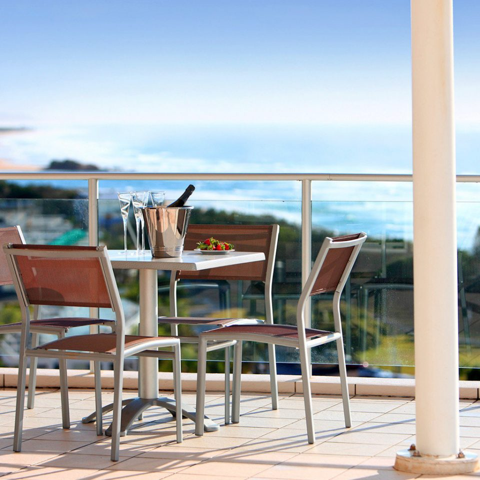 Balcony Dining Drink Eat Outdoors Resort Scenic views sky chair ground leisure Beach property walkway Ocean home Sea dock boardwalk lawn Deck empty set overlooking day