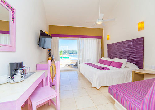 Balcony Beachfront Bedroom Boutique Budget Rustic Scenic views Waterfront property Suite cottage Villa pink purple