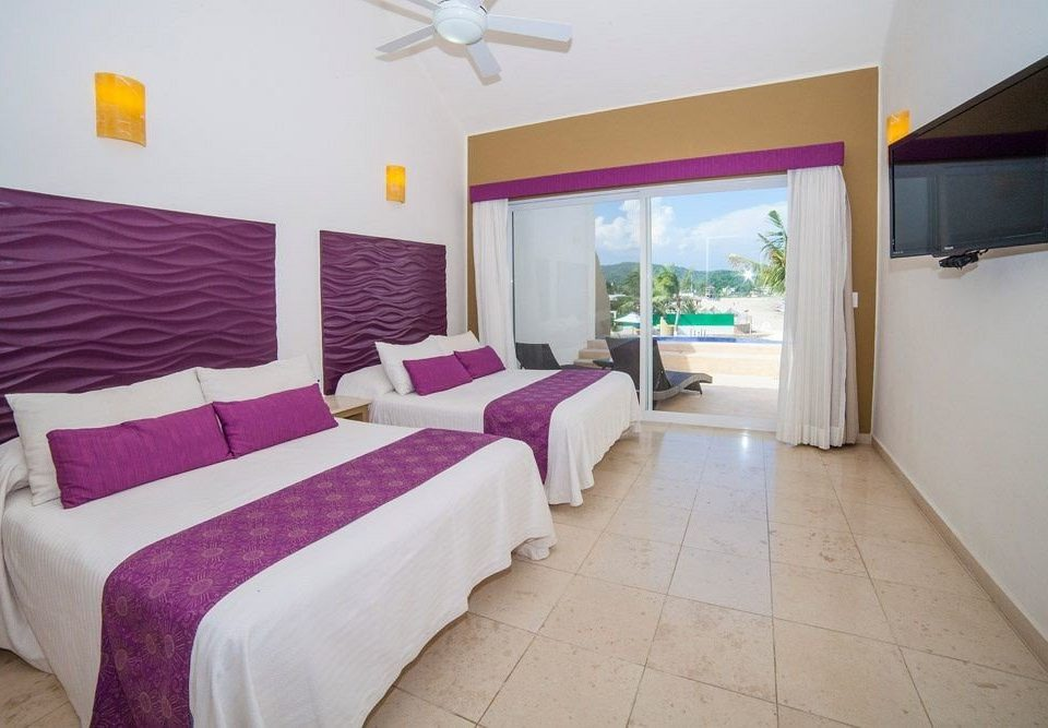 Balcony Beachfront Bedroom Boutique Budget Rustic Scenic views Waterfront property Suite cottage Villa purple colored