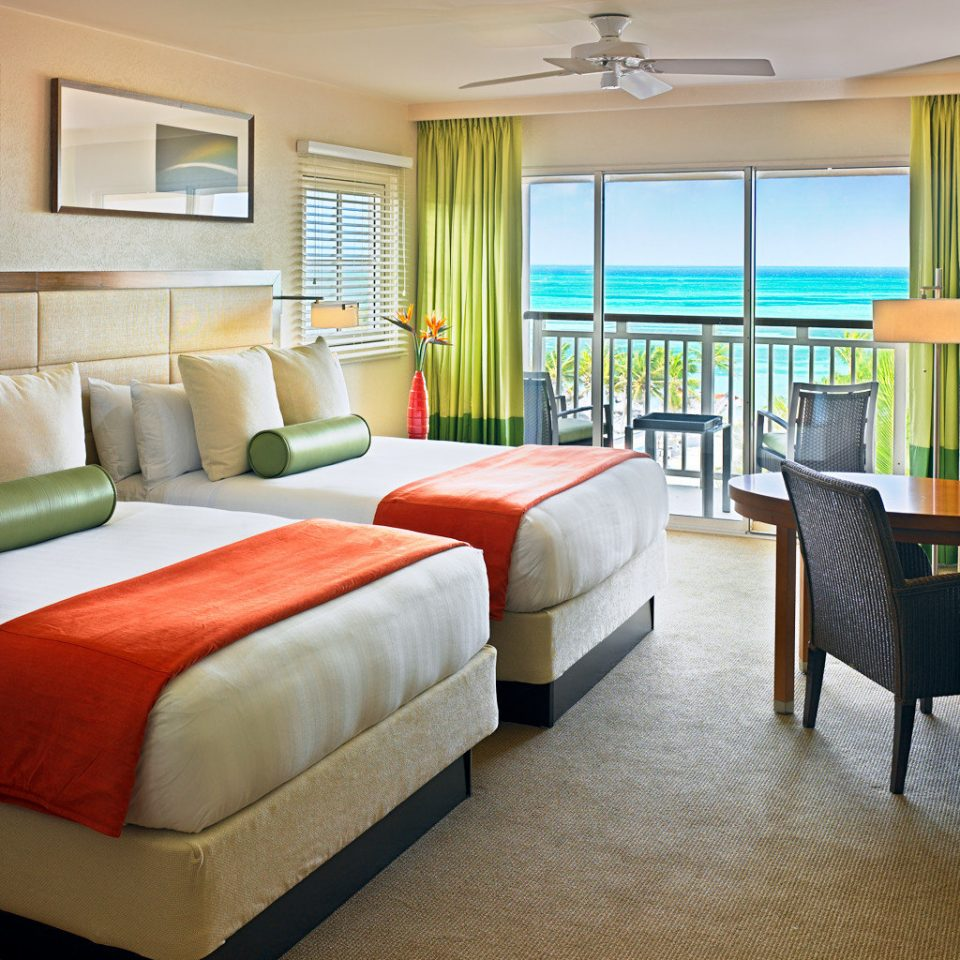 Balcony Beachfront Bedroom Casino Classic Resort Tropical sofa property chair living room Suite condominium home cottage