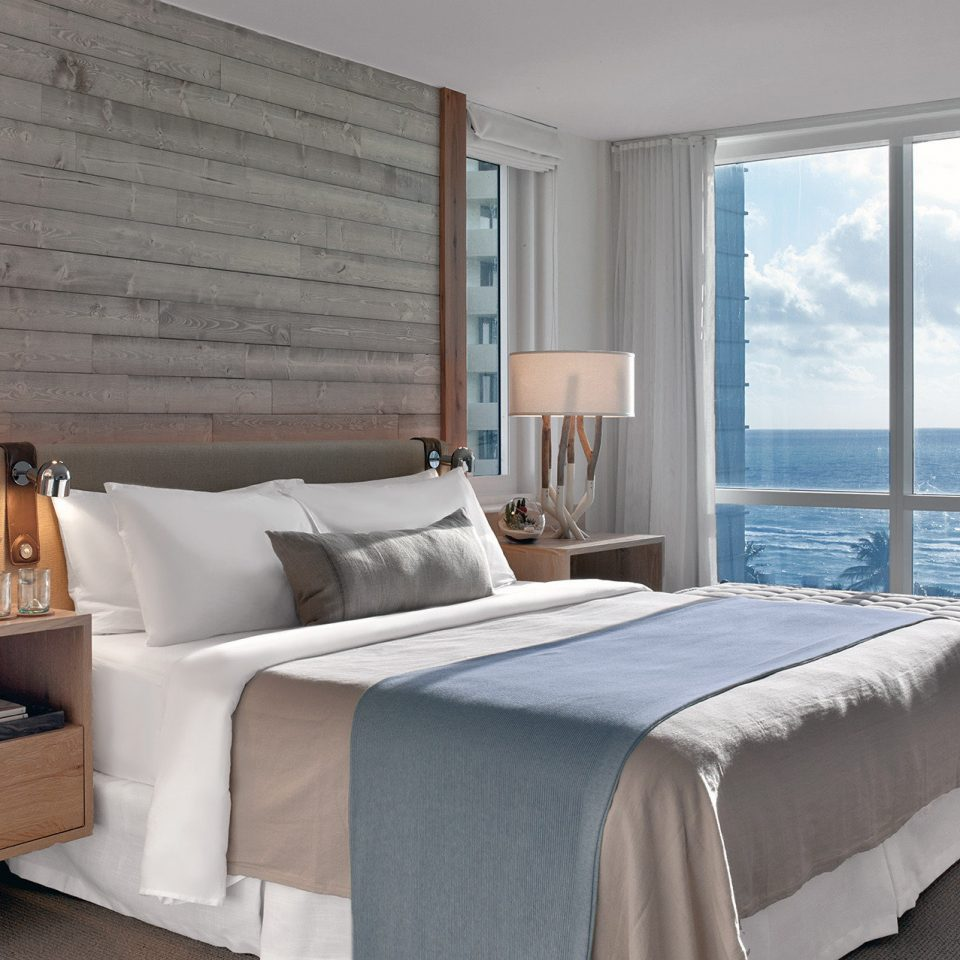 Balcony Beachfront Bedroom City Health + Wellness Hotels Luxury Miami Miami Beach Romance Romantic Suite Trip Ideas Yoga Retreats sofa property home living room cottage bed frame bed sheet