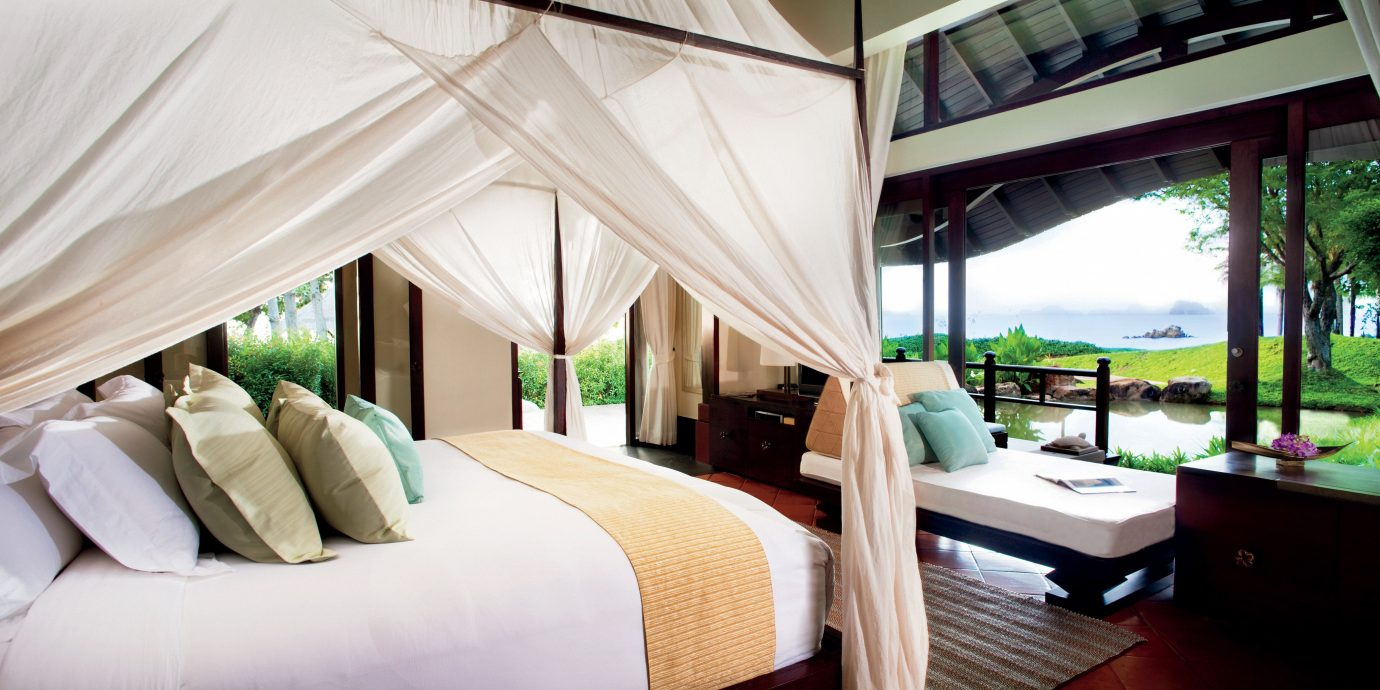 Balcony Beachfront Bedroom Cultural Elegant Honeymoon Influencers + Tastemakers Jungle Luxury Nature Patio Romance Romantic Scenic views Travel Shop Trip Ideas Tropical sofa property Resort home Villa pillow cottage Suite