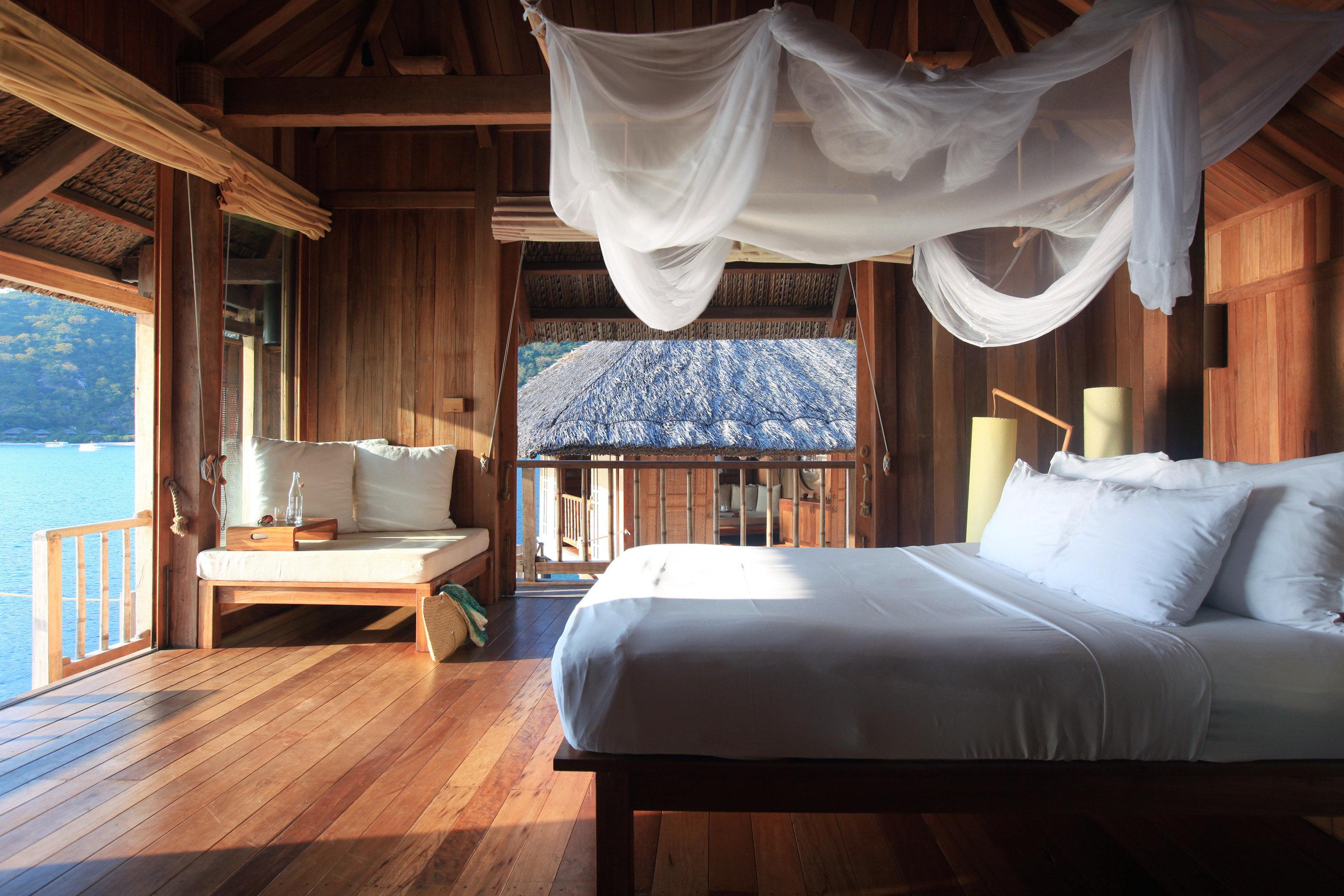 Balcony Beachfront Bedroom Elegant Jungle Romance Scenic views Tropical Villa Waterfront sofa property cottage Suite home Resort living room