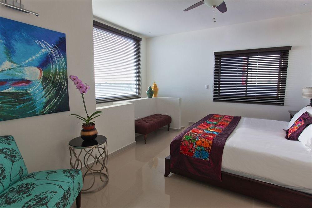 Balcony Beachfront Bedroom Elegant Luxury Scenic views Suite property living room condominium cottage