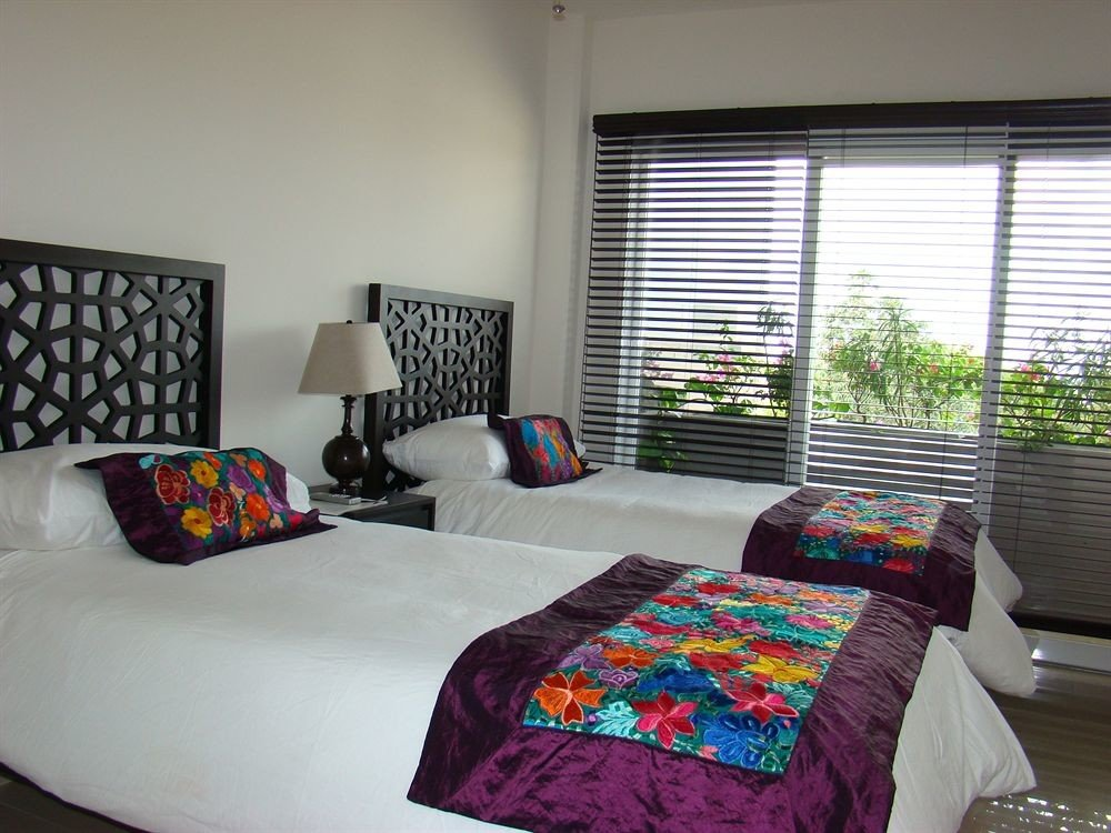 Balcony Beachfront Bedroom Elegant Luxury Scenic views Suite property cottage home bed sheet pillow living room