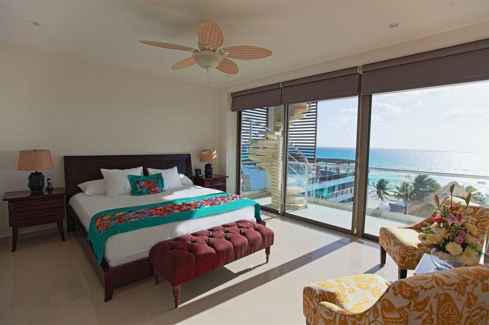 Balcony Beachfront Bedroom Elegant Luxury Scenic views Suite property Resort Villa cottage home