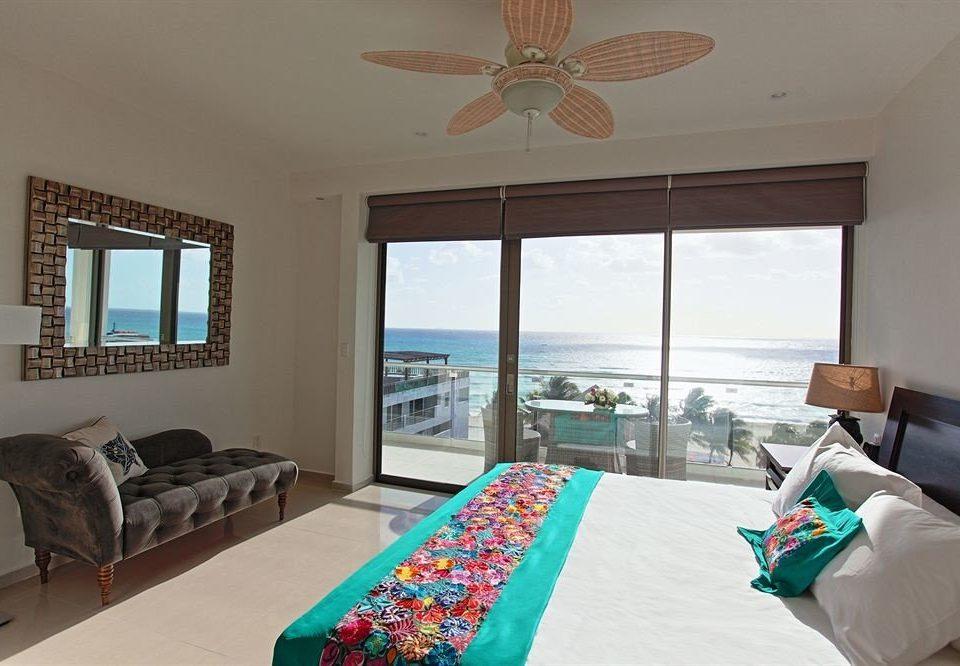 Balcony Beachfront Bedroom Elegant Luxury Scenic views Suite sofa property living room home cottage Villa