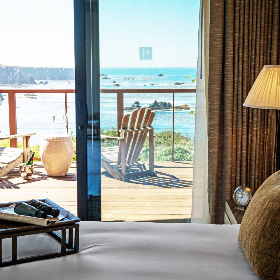 Balcony Beachfront Bedroom Elegant Scenic views Suite property home house living room condominium cottage nice overlooking