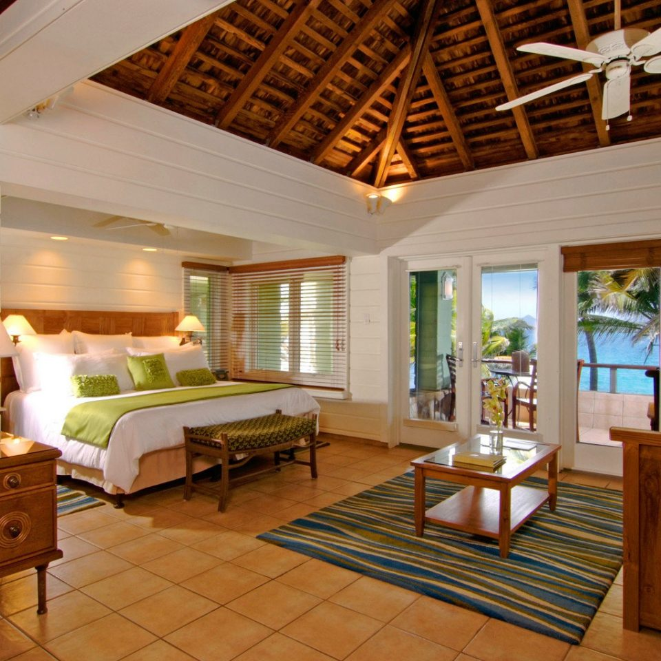 Balcony Beachfront Bedroom Elegant Island Patio Resort Romantic Suite Waterfront property home house living room Villa cottage hardwood farmhouse mansion wood flooring