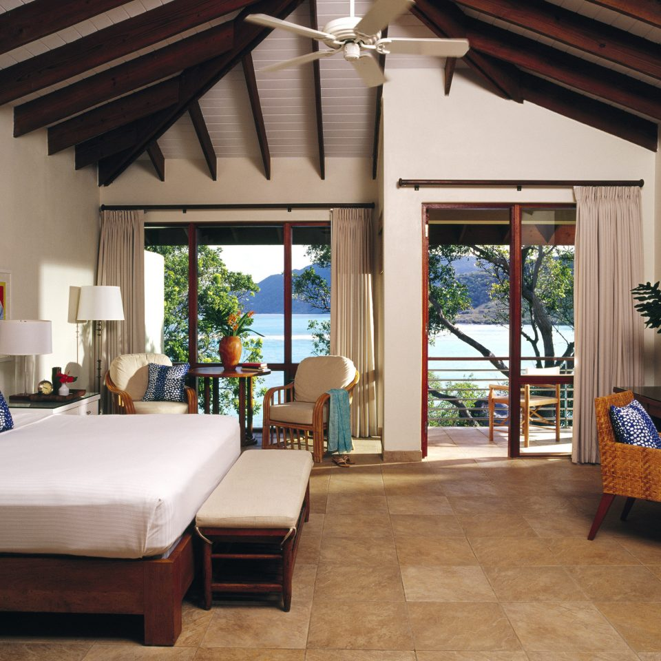 Balcony Beachfront Bedroom Elegant Island Resort Romantic Scenic views Suite Terrace Waterfront property living room house Villa home cottage porch farmhouse outdoor structure