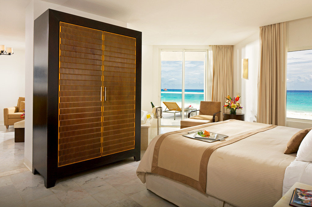Balcony Beachfront Bedroom Elegant Luxury Scenic views Suite property condominium