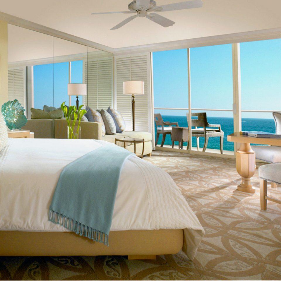 Balcony Beachfront Bedroom Elegant Hotels Modern Ocean Scenic views Waterfront property Suite home cottage living room condominium Villa