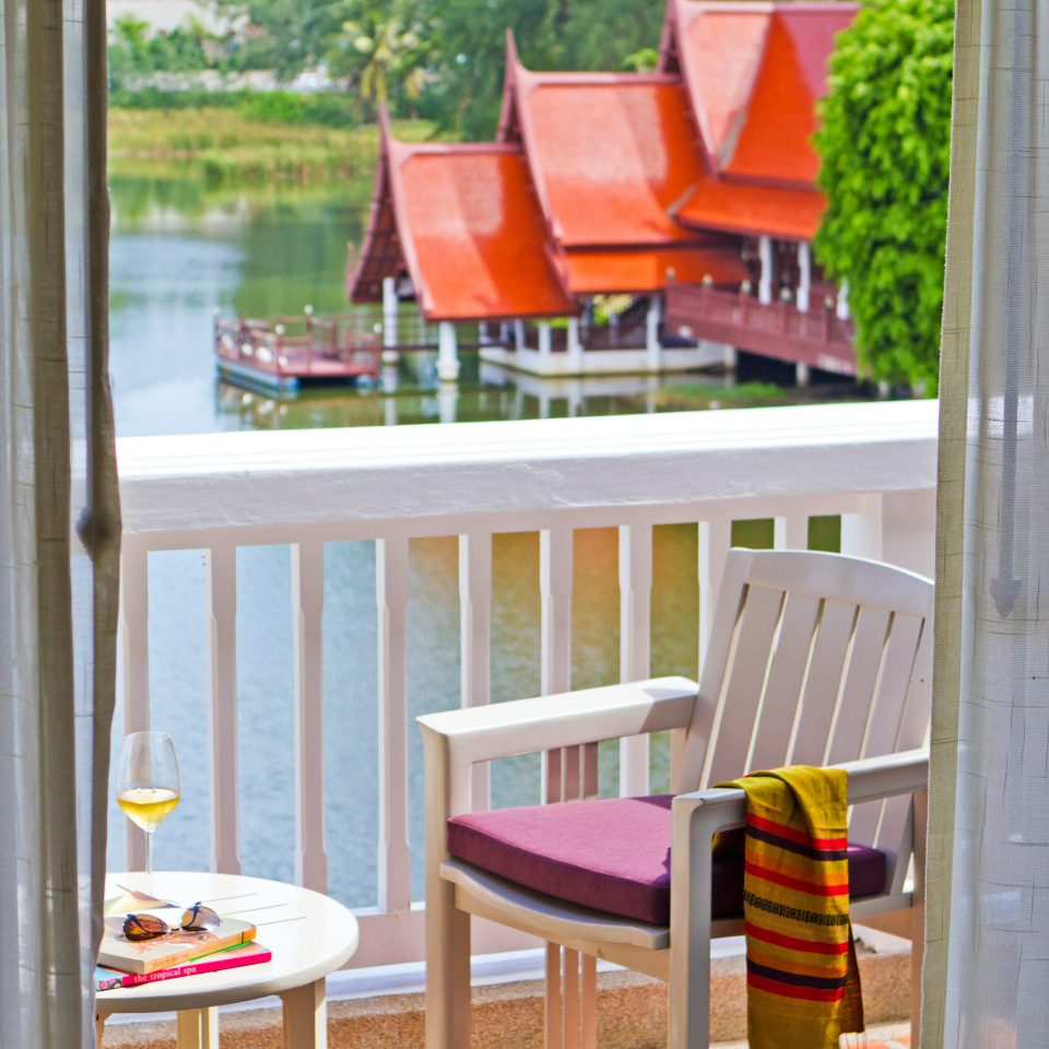 Balcony Beachfront Bedroom Family Island Resort Tropical Waterfront chair porch product home Play outdoor play equipment cottage outdoor structure backyard